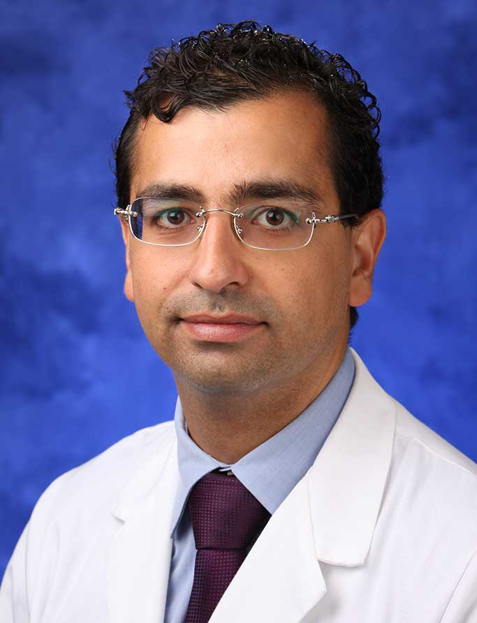 A head-and-shoulders professional photo of Dr. Elias Rizk