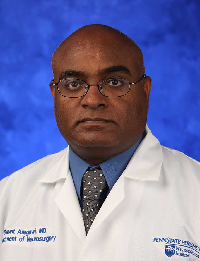 A head-and-shoulders professional photo of Dr. Dawit Aregawi