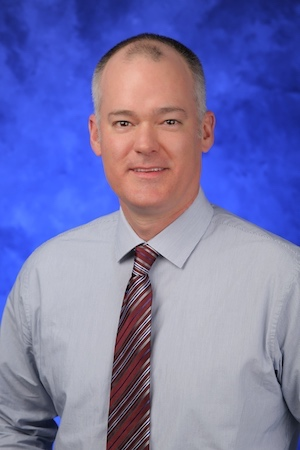 A head-and-shoulders professional photo of Douglas Leslie, PhD