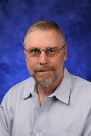 A head-and-shoulders professional photo of Ian Simpson, PhD