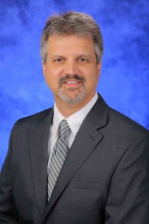 A head-and-shoulders professional photo of Dr. Todd Schell