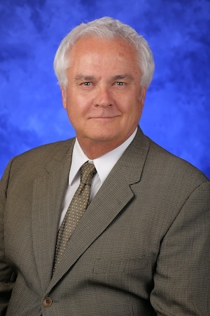 A head-and-shoulders professional photo of James Connor, PhD