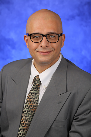 A head-and-shoulders professional photo of John Elfar, MD