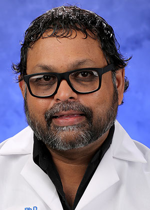 A head-and-shoulders professional photo of Dr. Thomas Abraham