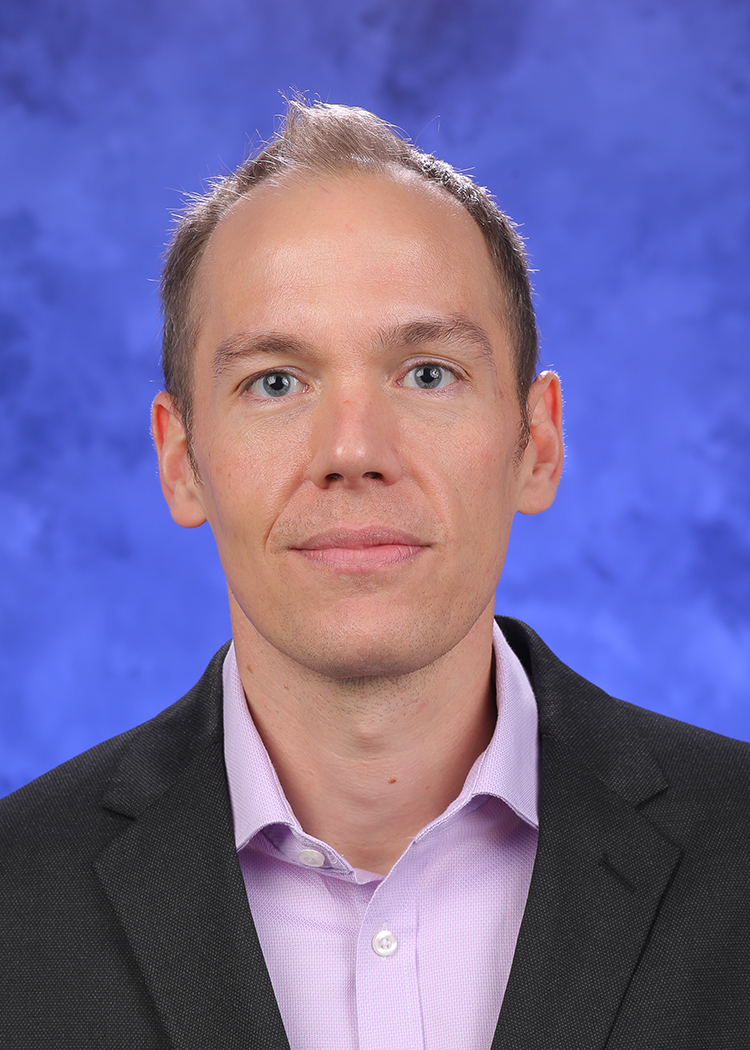 A head-and-shoulders professional photo of Guy Townsend, PhD
