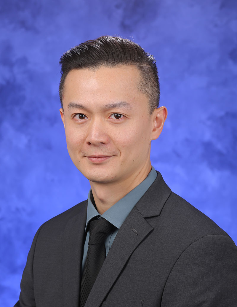A professional head-and-shoulders photo of Kenneth Pak Kin Lee