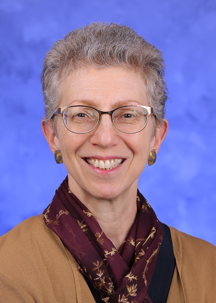 Bernice Hausman, PhD, is chair of the Department of Humanities at Penn State College of Medicine. She is pictured wearing a professional outfit and scarf.