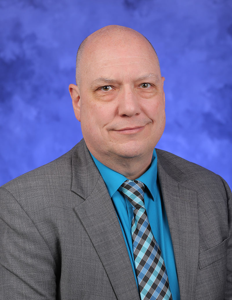 A head-and-shoulders professional photo of Dr. Gregory Holmes